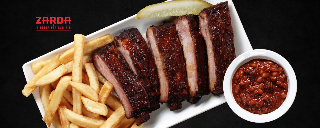 Classic Rib Plate + 2 Classic Sides $10.99 all October at Zarda BBQ!